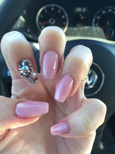 Nails by Lauren ballerina shaped nails or coffin shaped nails with pink gel polish and swarovski rhinestone crystals