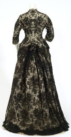 One-piece dress of ivory moiré with one-piece bodice and overskirt of black lace (Chantilly-like). Circa 1870's. mnhs.org