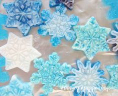 Melt blue and white hard candy to make these pretty snowflake candies. See how at HungryHappenings.com