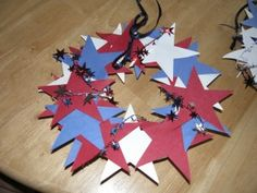4th of July craft great for kids and makes a nice wreath for your door! I am always a fan of red, white & blue