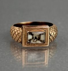 Georgian 9CT rose gold momento mori with painted skull miniature, c. 1814. Found on ebay