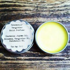Patchouli-Tangerine Solid Perfume  15 ml Jojoba Oil  50 drops Patchouli Essential Oil  40 drops Tangerine Essential Oil  5 grams Beeswax