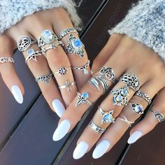 Plain white acrylic nails.
