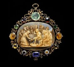 Gold pendant, the frame set with gems between scrolls,enclosing a large brownish chalcedony cameo illustrating the event from the Bible, recorded by St. John, 13, vv. 4-17, when Jesus Christ, knowing that his end was near, washed the feet of his disciples, as an example of perfect brotherly love.