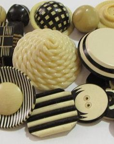 Cream and black, art deco, celluloid buttons.  Love!