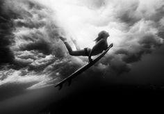 Coco Ho duckdiving beneath a wave