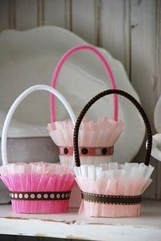 easy to make, mini treat baskets, made with dixie cups, tissue paper, and pipe cleaners.: