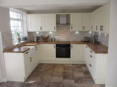 The the cupboards. The floor and worktop are lovely
