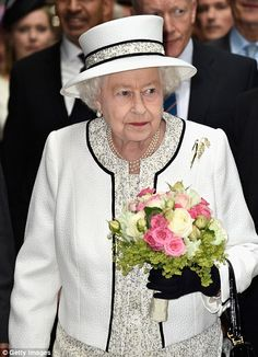 I love this outfit. Entourage: Her Majesty arrived holding a bouquet of flowers and was surrounded by heavy security in the French capital. D-Day in France, 2014.