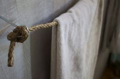 Now here's a unique way to infuse some nautical into the bath. A towel rack made of rope.