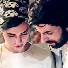 Tuba Buyukustun as Elif and Engin Akyürek as Omer in KARA PARA ASK the Turkish TV series, 2014.