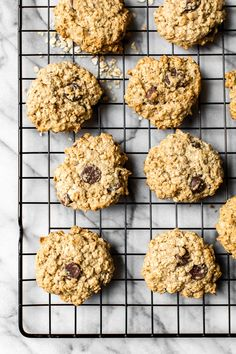 These Chewy Chocolate Chip Oatmeal Cookies are moist and made light by swapping out most of the butter for applesauce which works great! #oatmealchocolatechipcookies #cookies #oatmealcookies #holidaybaking #skinnytaste