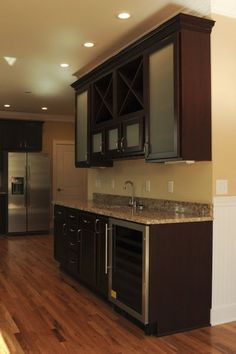 DHD Style: Wet bar / Butler's pantry with bar sink, granite, wine fridge, and wine racks