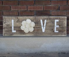 """Reclaimed Pallet Wood Sign - LOVE 38""""X11"""" Choose your own color!  Rustic pallet wood with the word """"Love"""" is completed by adding our beautiful sola wood flowers.    38 inches X 11 inches.  Includes mounting bracket on the back for easy hanging.  Color shown is natural white."""