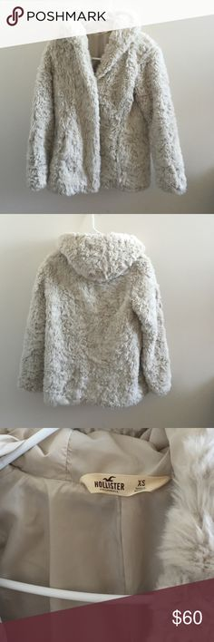 Hollister Faux Fur Coat *LMK IF INTERESTED!* Amazing condition! Only worn a couple of times! I love this it is super cute unfortunately I just don't wear it enough to keep it around anymore! The inside is lined so it is not faux fur on the inside, closes with two snaps, has a hood. Make me an offer I am flexible!  ***LMK IF YOU'RE INTERESTED!*** Jackets & Coats