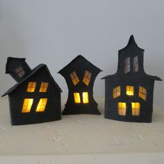 Light up your Halloween decorations with these creepy house luminaries made from felt.