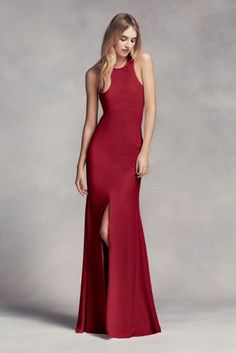 Dramatic lines define this long racerback bridesmaid dress with a cutaway  halter neckline dadd25bf8474