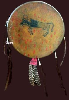 Crow shield replica - circa mid 19th century (with human hair locks) - New Orleans Museum, Louisiana