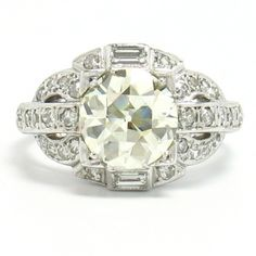 1920's Platinum & Diamond Ring, 2.03ct L-VS1 - This 1920's bombe ring is crafted in platinum and features one 2.03 carat Old European cut diamond rated L color, VS1 clarity. -                                                                                                   $16,500.00                                           - http://www.excaliburjewelry.com/shop/rings/engagement-rings/1920-s-platinum-diamond-ring-2-03ct-l-vs1.html