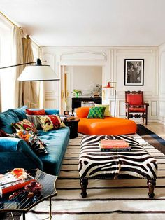 Bold Colorful Home Decor Inspiration | Living Room Decorating Ideas | Orange Chair | Zebra Ottoman | Blue Velvet Couch