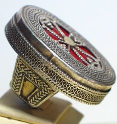 Large silver ring from Kazakhstan, decorated with red glass.