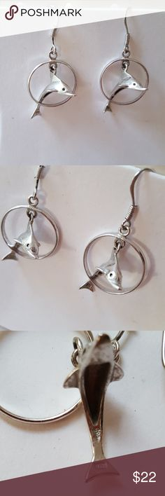 """Sterling silver dolphin earrings Sweet Sterling silver dolphins jumping through a hoop. Earrings are marked 925 (last image) and are 1.5"""" long. Perfectly mermaidy ❤ Vintage Jewelry Earrings"""
