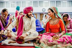 Indian bride and groom talking smiling during Sikh wedding