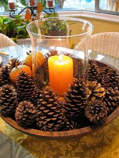 Pine Cone Arrangement Need a centerpiece that takes less than five minutes to make? Just place pine cones in a large bowl and place a hurricane vase holding a candle in the middle. Get the tutorial at May Days.