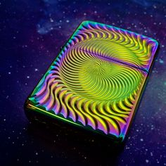 Full Circle, Zippo's 2015 Collectible of the Year. Zippo owner George Duke personally selected this design created by his son Grant, fourth-generation member of the Zippo family. The design is an outstanding example of the philosophy behind every Zippo lighter - the infinite repetition of an engraved never-ending spiral represents the reusable nature of the product as well as the passing of the flame from generation to generation in the Zippo family.