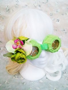 Steam Kei Steampunk Goggles with Bright Lime Green with Orchid flowers These Steampunk Goggles are inspired by the Visual and Fairy Kei styles popular in Japan.    Trying out a new twist and calling it Steam Kei    These