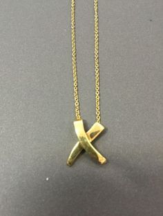 "Tiffany & Co Paloma Picasso 18k Yellow Gold Kiss Medium Pendant Necklace 16"" - http://elegant.designerjewelrygalleria.com/tiffany/tiffany-co-paloma-picasso-18k-yellow-gold-kiss-medium-pendant-necklace-16/"