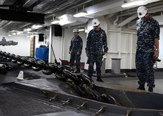 PACIFIC OCEAN (Sept. 6, 2013) Lt. Cmdr. Steven Reynolds, right, from Antioch, Calif., observes the raising of an anchor chain during a drop test aboard the aircraft carrier USS Ronald Reagan (CVN 76).