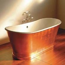 Salvaged from an old home this free-standing tub design is based on antique copper washtubs from the Old West