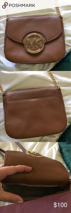 Great Michael Kors crossbody purse! Never used Michael Kors brown crossbody purse! In perfect condition, I paid $150 for it. I have an IPhone 7+ with a defender Otterbox and it doesn't fit inside which is the only reason I'm selling it. Adjustable strap with leather and chain. Gorgeous! All of my items ship quickly from a smoke free home. Thanks for looking. Michael Kors Bags Crossbody Bags