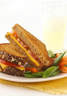 Better-for-You Grilled Cheese Sandwich – Grilled cheese gets a Healthy Living makeover when made with multi-grain bread and fresh tomato, and served with baby carrots and sugar snap peas. This grilled cheese sandwich is sure to become a lunchtime favorite.