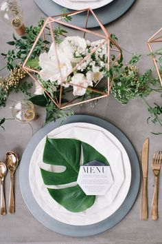 Modern Wedding Centerpiece and place setting. Greenery accents. Palm leaf under menu. Perfect for a tropical, destination wedding on some beach, somewhere. #weddingmenu