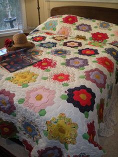 Hand-pieced and hand quilted flower garden quilt  bluebirdgardens.com