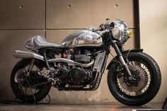 """Benjie's Cafe Racer don't just sell parts, they also build amazing bikes too—like this Triumph Thruxton """"Steampunk Racer"""" with a Honda CBR1000RR front end."""