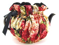 Lots of pretty tea cozies ~ beehive and wrap around.