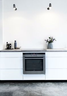 Love this look. Concrete floors and countertops...no stain. Natural, clean, simple and rustic