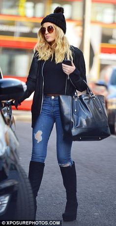 Woman in black: Edwards, 21, wore a suede jacket with a black top, distressed jeans and kn...