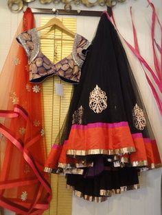 Black net lehenga with black brocade embroidered blouse