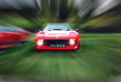 Ferrari 308 by Gary Bluemel. A fantastic abstract shot with a zoom burst technique.