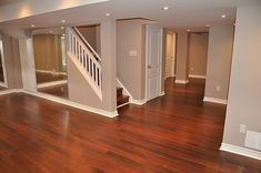 A Finishing Basement Reconstruction to Increase Your Home Value basement construction, basement wall reconstruction Basement Makeover, Basement Renovations, Basement Ideas, Cherry Wood Floors, Brazilian Cherry Hardwood Flooring, Basement Construction, Basement Bedrooms, Modern Basement, Colors