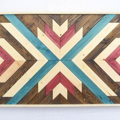 Red and Blue Wood Wall Art Hanging - Perfect focal point for your wall or for a space that needs something special and unique to enliven it. Each piece is made exclusively with locally sourced wood.