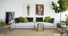 "CB2's made-for-lounging Uno sectional stretches along the long wall of the living room; hanging above it, the 1970s Luciano Miori gouaches ""have this powerful mystery,"" Scheerer says."