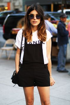 Simple and fierce in short, black overalls and a white tee.