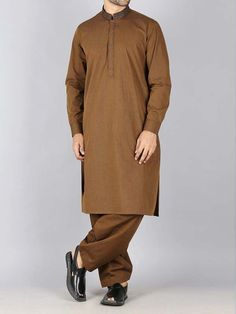 Here is the latest Pakistani men kurta shalwar kameez designs by top Pakistani designers. All of latest men kurta design for men are shown with pictures. Mens Shalwar Kameez, Kurta Men, Luxury Mens Clothing, Mens Clothing Brands, Gents Kurta, Design Kaos, Islamic Clothing, Kurta Designs, Mens Fashion