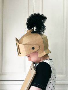 A fun DIY on how to make a Knight's helmet out of cardboard for a great costume dress-up.