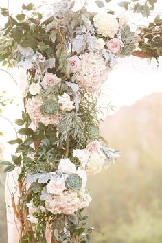 Four Seasons Scottsdale wedding, in blush and navy, with a Tara LaTour navy wedding gown. Florals in natural greens, white and beautiful succulents.